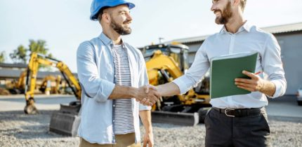 workers-shaking-hands-construction-site-430x210.jpg